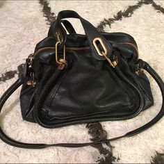 """Chloe Paraty Medium Leather Satchel Authentic. Comes with authentication card and dust bag. I love this bag but it doesn't get as much use as it should. Two minor signs of wear to mention: the raised """"piping"""" (part of the design) that outlines the bag shows some very minor fading (shown in photo 2), which is not noticeable at all when carried. Also the hardware has just the tiniest hint of fading in some spots, but still looks very gold as you see in photos. Interior is clean. Leather is a…"""