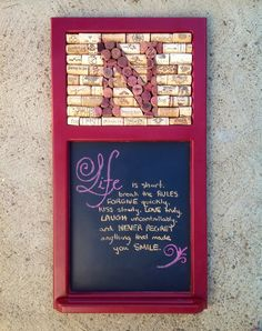 Refurbished chalkboard I found at Goodwill.  I painted the frame and tore out the top piece and replaced with wine cork.