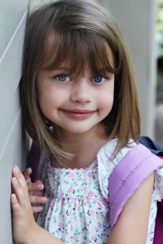 Long bob with bangs..... such a cute little girl
