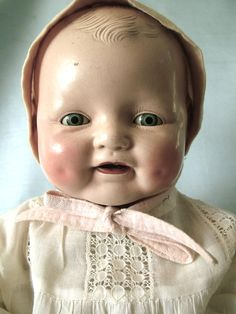 "19"" Baby Dimples Doll made of composition and cloth, 1928, Horsman Doll Company, United States.  Baby Dimples came in sizes ranging 16-18"" and 22-24"" and hand sleeping eyes."