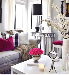 Pretty pops of pink in this living room decor