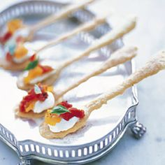 Creamy Goat Cheese with Sun-dried Tomatoes on a Crispy Spoon-Shaped Cracker