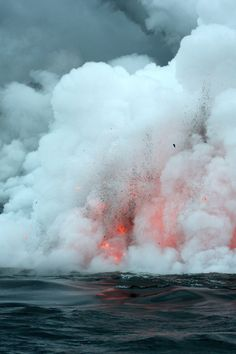 Kilauea volcano lava flow spitting into the air and ocean Hawaii Vol