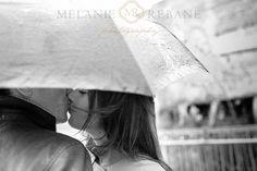 Romantic engagement session in the rain