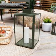 Green metal lantern in the size small. The lantern has a glass door that can be opened/closed with a small hook. German Store, Metal Lanterns, Glass Door, Candle Holders, Indoor, Candles, Mini, Table, Oasis