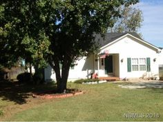 Great investment, starter or downsizing home. Garage has been converted to a den/laundry room, Could be 3rd bedroom. W Heater replaced'09, Shingles replaced'11.Duke Energy, No city taxes but close to town. Comes with lot to the rear +.45 acre. Call Paula for more information @ 252-349-8900.