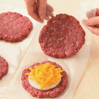 to Make Stuffed Burgers How to Make Stuffed Burgers: Our grilling gurus share an easy technique for onion- and cheese-stuffed beef burgers.How to Make Stuffed Burgers: Our grilling gurus share an easy technique for onion- and cheese-stuffed beef burgers. Grilling Recipes, Meat Recipes, Cooking Recipes, Healthy Recipes, Grilling Tips, Dinner Recipes, Hamburgers, Grilled Hamburger Recipes, Burgers On The Stove