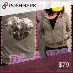 PINK~ Medium hoodie ~ Victoria Secret EUC. ~~~RARE~~~Pink brand --> Grey with silver sparkles hoodie. Zipper in excellent condition. Back heart is made of silver sequins and is intact and in good condition. The silver arrow going through the heart has minor cracking; it is barely noticeable because the colors are so similar. This is a gorgeous PINK sweatshirt weight size medium zipper hooded jacket. Feel free to make an offer 💜 PINK Victoria's Secret Tops Sweatshirts & Hoodies