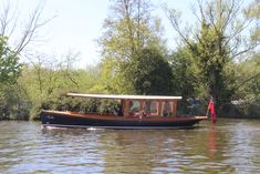 A classic river launch on the River Bure at Horning in Norfolk