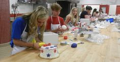 Students working hard at our 4th of July cake decorating class.