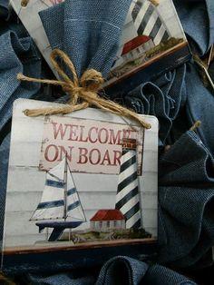Μπομπονιέρα βάπτισης μεταλλικό vintage θαλασσινό καδράκι πάνω σε τζιν πουγγί.