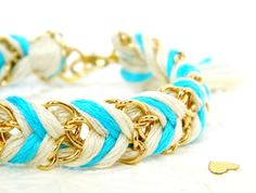 braided chain and chevron bracelet.  totally going to make this.  the knot at the end looks like a tassel.