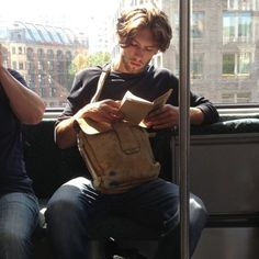 """Spotted this scruffy prince on his morning commute. Probably to sculpture class. I'm sure he's reading a collection of post-war Russian short stories, but really thinking of how he made love to his French girlfriend this morning and the gluten free toast they shared after. #marryme"""