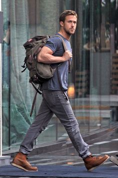 Ryan Gosling dabbling in the Lumbersexual look while arriving on the set of a Hollywood film. Notice the Jansport Pleastanton, a leather lumberjack-style pack complete with laptop sleeve, and the RedWing 875 work boots.