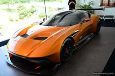 British luxury carmaker Aston Martin introduced its track-only Vulcan supercar finished in bright orange. The beast car, can be seen at the Nürburgring Aston Martin Vulcan, Car Racer, Shabby Chic Homes, Super Cars, Orange, Luxury, Vehicles, Exotic, Sketch