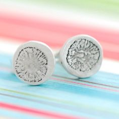 tiny poppy earrings stamped on a fine silver circle // #ChocolateAndSteel