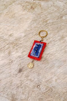 Fabric keychain with embroidery and bronze/brass by Mioltu on Etsy, €25.00