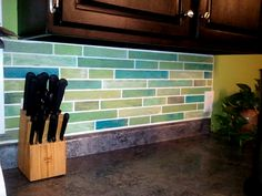 Painting faux tile backsplashes in the kitchen. This is masterful. OMG. I have commitment issues with tile. This is perfect!
