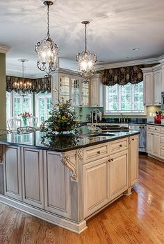 Beautiful kitchen with elegant light fixtures.