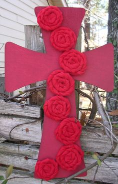 Just finished making this red rose beauty for Valentines.  Hand painted cross and hand wrapped fabric roses. $25.00    Hand Painted Red Cross - Handmade fabric Roses Rosettes