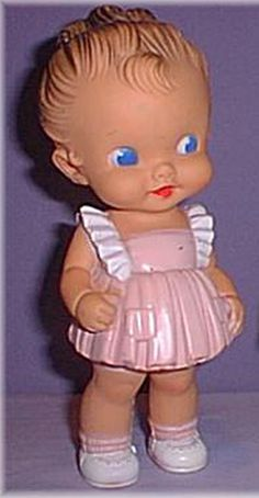 I had a doll like this in a yellow dress.