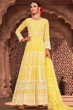 Elegance and charm is what you will exude once you get this Yellow Net Anarkali Suit which will make all the goddesses of love and beauty to write you for your advice. This Round neck and Full Sleeves dress embroidered with zari, lucknowi, stone, dori and mirror work. #yellow #anarkali #indian #Andaazfashion #USA