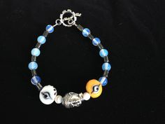 Hematite, opal, rolled glass beads and Pewter Charm