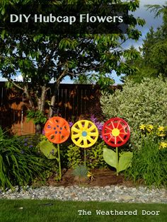 The Weathered Door: Hubcap Flower Yard Art.  No way!  Heck, you can pick hubcaps up off the side of the road!