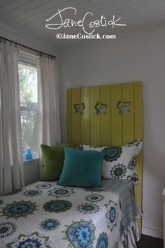 a Jane Coslick  Shutter headboard in the twin room
