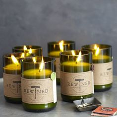 Soy wax candles in recycled wine bottles - scents are different types of wine plus mimosa and sangria.