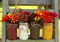 i have these colors in my kitchen, so I've started painting some old mason jars I have to do this! I have the red and I changed the white to a cream, but now just need the yellow and green and walla! Ill be done!
