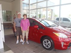 William and his wife in their shiny new, red 2013 #Prius -- July 2013 -- Welcome to the #DavidMausToyota family! #hybrid #ecofriendly #fuelefficiency