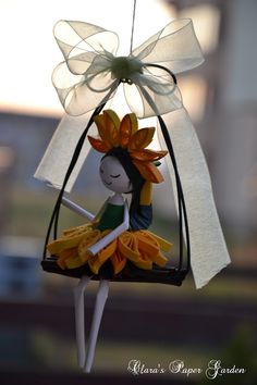 Quilled little girl on a swing