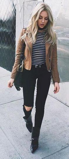 stripes. skinny jeans. tan leather jacket. street style.