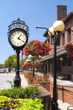 Fargo, North Dakota historic railroad depot, restored and converted for use as a senior citizens center, features the vintage clock and lampposts with hanging flower baskets