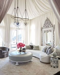 """26Martyn Lawrence Bullard tented Khloé's living room with a sheer fabric of his own design and grouped a vintage sofa from John Salibello with a Levantine mirror and a rug by Anthony Monaco."" @archdigest"