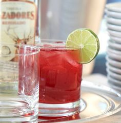 Merry Margarita: 1½ parts Tequila Cazadores® Reposado, 2 parts pomegranate juice, ½ part sour mix  ½ part triple sec, ½ part grenadine, splash of fresh lime juice. Shake ingredients with ice and pour into a rocks glass. Garnish with a slice of lime.