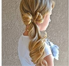 Look a this beautiful bow/ponytail! Just slick your hair back (dry hair please), take two parts of your side ponytail, put them in a bow formation, (one at a time) Bobby pin them down., and take one more small section, wrap it around the bow, and pin it. Then curl (if desired)