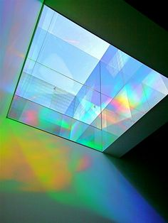 The five foot square and ten foot high Solar Light Shaft is capped with a plexiglas skylight . It gathers sunlight for this public art installation – from dawn to dusk all year. The Shaft is lined with prisms and mirrors that optically mix the six primary rainbow colors into millions of new colors and forms – hour by hour.