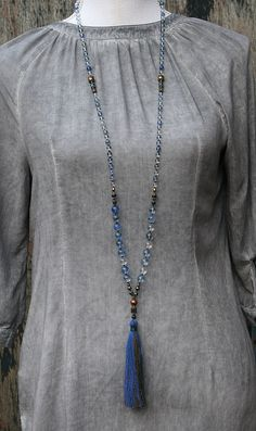 Mala necklace made of 6 and 10 mm - 0.236 and 0.394 inch, beautiful glass stones. Together they count as 108 beads. The mala is decorated with hematite. The total length of the mala necklace is approximately 111 cm - 43.70 inch.