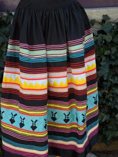 Southwestern Skirt by SomethingElseAgain on Etsy, $80.00 This is similar to a jacket that my father in law purchased from an American Indian--Seminole we think. It also looks similar to some Hmong work I have seen. Beautiful at any rate.