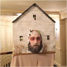 "My friend, artist Bill Crisafi, attended in a creation he named, ""A Haunting in New England,"" in which he personifies the haunting. Inside the house, each room is meticulously furnished and decorated with miniature objects."