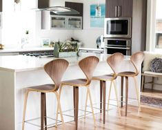 The classic and shapely Norman Counter Stool is one of the most iconic pieces of mid-century furniture. This molded plywood piece offers not only timeless appeal and sophistication, but also comfort and stability. Designed with tapered legs, a generous curved seat, and a concave backrest that is widest at the shoulders, the contoured form lets the body relax easily. The Norman Counter Stool's organic, streamlined shape allows it to feel at home in all environments.