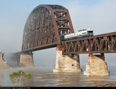 Creative Charters Warren R Henry brings up the back end of Amtrak's Kentucky Derby train as it crosses a flooded and fog enshrouded Ohio River entering Louisville Kentucky.