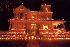 "The ""Pumpkin House"" is decked out in thousands of carved pumpkins every year at Halloween in Kenova, West Virginia."