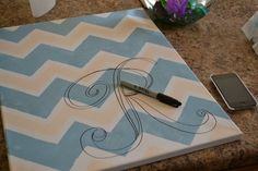 DIY Chevron Wall art – one with each of our initials over the bed. Or maybe just 1 with a monogram