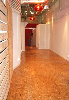 Particle board provided inexpensive flooring in this soon-to-be boutique. Copious amounts of clear polyurethane finish highlighted the funky texture of the particle board and gave the floors an exotic look customers could not stop raving about.