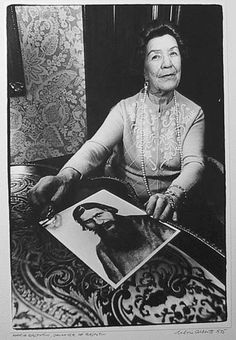 Maria Rasputin with a photograph of her father