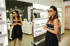 POP, The Bridal Event is a one-day event that takes place at one of Los Angeles' newest and most prestigious outdoor shopping destinations. This year, well over 40 vendors turned out to offer brides and their friends and families advice, services, exclusive discounts and more. This photo features Mario Lopez's wife Courtney Lopez trying on Ray-Bans inside ILORI at The Americana at Brand. Photo Credit: Duke Photography.