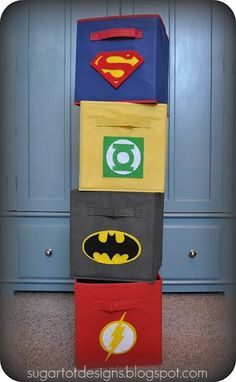 Superhero storage bins. Great idea for boys rooms!  Maybe tape colored pictures on the plastic bins we have.